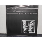 """THE HEARTSIDE IS TRAPPED IN COSTA'S CAKE HOUSE - 7"""" GERMANY"""